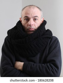 portrait of adult male short hair black scarf around his neck and head