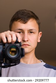 portrait of adult man with black camera