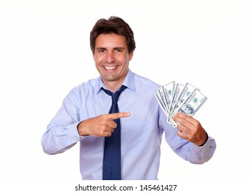 Portrait of an adult man pointing and holding up cash money against white background