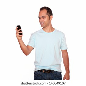 Portrait of an adult man sending message by cellphone on isolated background