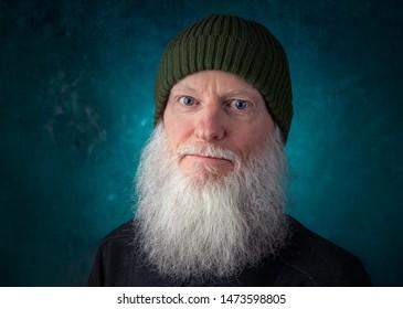portrait of adult man senior with cap