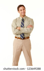 Portrait of an adult man wearing khakis and a shirt and tie looking at camera isolated on a white background