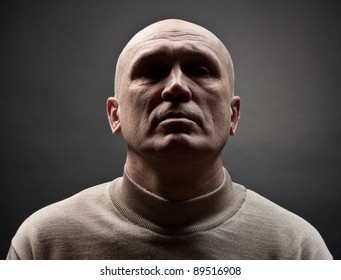 Portrait of the adult person. A black background