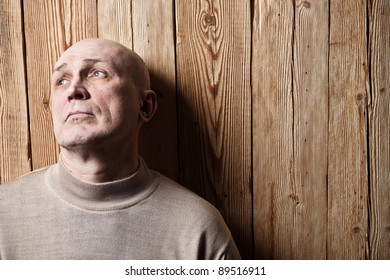 Portrait of the adult person. A wooden background