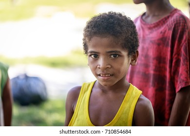 Portrait of Aeta tribe little boy near Mount Pinatubo on Aug 27, 2017 in Santa Juliana, Capas, Central Luzon, Philippines. the people suffer of poverty due to the bad economy, political issue.