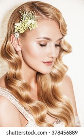 Portrait of affectionate blond woman. Beautiful bride with wedding makeup, hairdo and wedding decorations. Wedding ideas and bridal style.