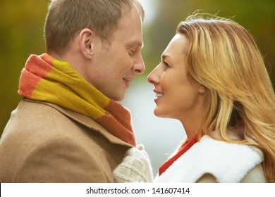 Portrait of affectionate couple looking at one another with smiles