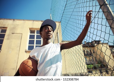 Portrait of african american boy with basketball looking away