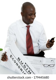 Portrait of an African American businessman reading a newspaper, isolated on white background