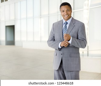 Portrait of an African American businessman wearing a suit standing in an outdoor business environment