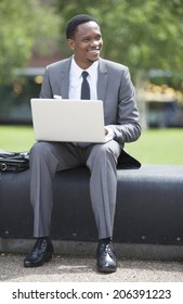Portrait of African American Businessman working on a laptop outdoors