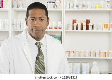 Portrait of an African American confident male pharmacist at workplace