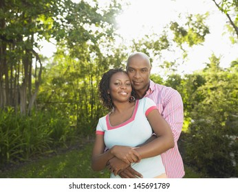 Portrait of an African American couple embracing in the garden