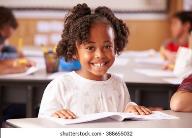 Portrait of African American elementary school girl in class