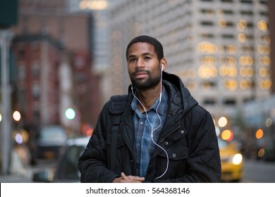 Portrait of African American man listening to music in the city, Photographed in Nov 2016.