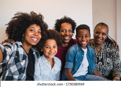 Portrait of african american multigenerational family taking a selfie together at home. Family and lifestyle concept.