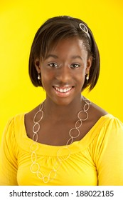 Portrait African American teen wearing yellow with yellow background.