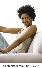 Portrait of African American woman sitting on sofa