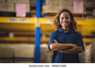 Portrait of African American worker in warehouse, International export business concept