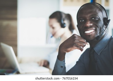 Portrait of an African American young business man with headset.