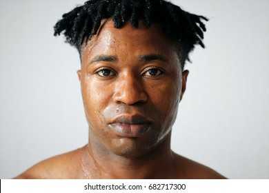 Portrait of African black man with wet face