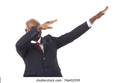 Portrait of African businessman in formal suit dabbing on white background