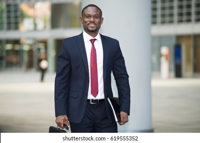 Portrait of an african businessman holding a briefcase