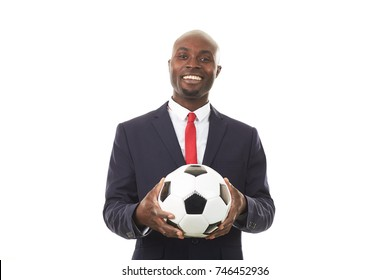 Portrait of African businessman holding soccer ball on white background