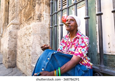 Portrait of african cuban woman smoking cigar in Havana, Cuba