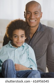Portrait of African father and son