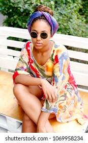 Portrait of an african female in sunglasses and with trendy hairstyle