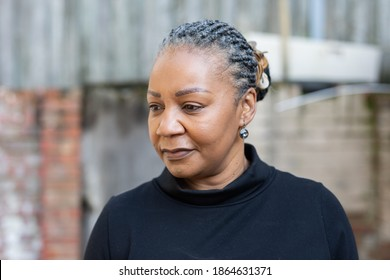 Portrait of an African healthy woman living with HIV looking away