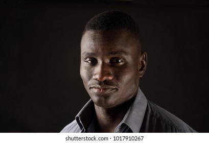 portrait of a african man on black