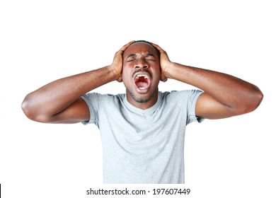 Portrait of african man shouting and closing ear by his hands on white background