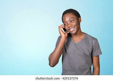 Portrait of african man talking on the phone isolated