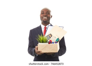 Portrait of African office worker holding box with personal belongings