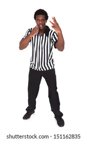 Portrait Of An African Referee Gesturing Over White Background