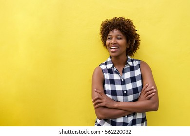 Portrait of african woman smiling against yellow background