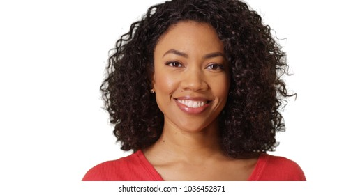 Portrait of African-American young lady smiling at camera on white copy space