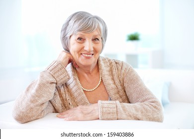 Portrait of aged female looking at camera with smile