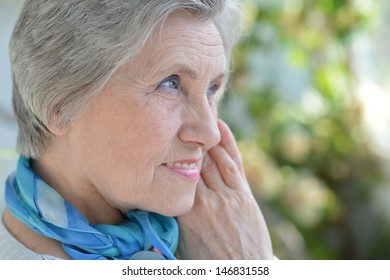Portrait of an aged woman with a blue neck scarf home
