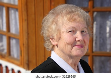 Portrait of aged woman outdoor