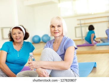 Portrait of aged women looking at camera in sport club