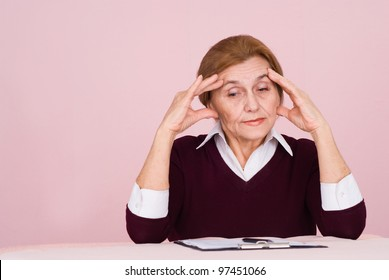 portrait of an aged worker with files