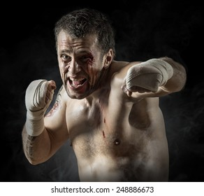 Portrait of aggressiv boxer in blood
