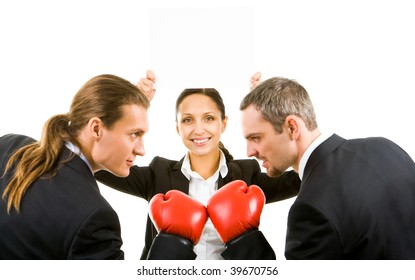 Portrait of aggressive businessmen in boxing gloves with happy female with blank paper between them