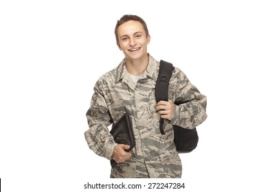 Portrait of air force airman college student with shoulder bag and digital tablet against white background