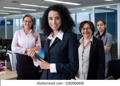 Portrait of an all female Brazilian corporate team in a Sao Paulo office