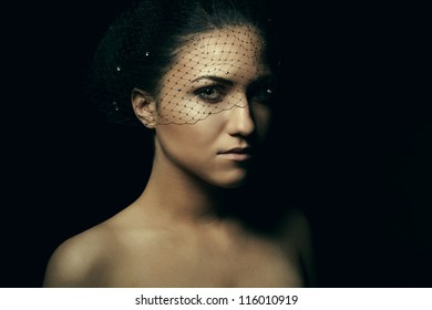 Portrait of alluring beautiful young women in veil closeup