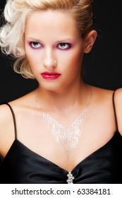 portrait of alluring blonde over black background